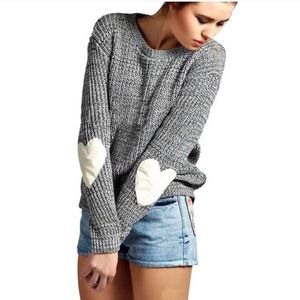Grey sweater white heart patch on elbow